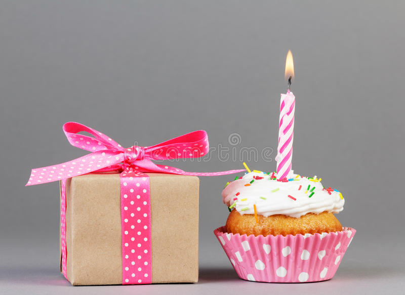 Cupcake with gift box royalty free stock images