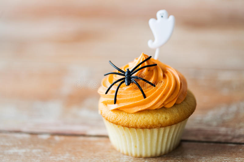 Cupcake with halloween decoration on table stock photos