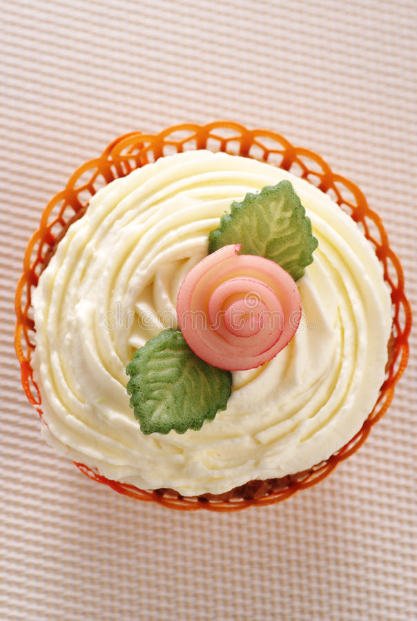 Cupcake with marzipan rose and leaves royalty free stock images