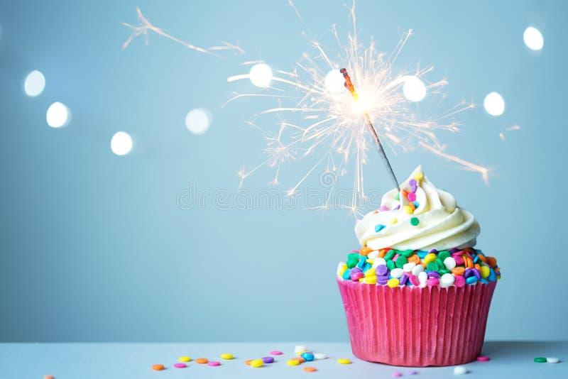 Cupcake met sterretje stock afbeeldingen