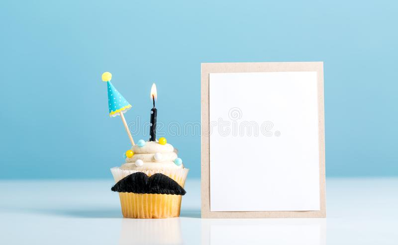 Cupcake with a moustache Father`s Day theme royalty free stock images