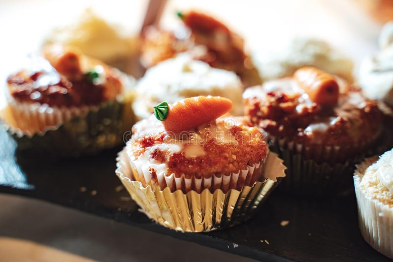 Cupcake or muffin decorated with a carrot royalty free stock photography