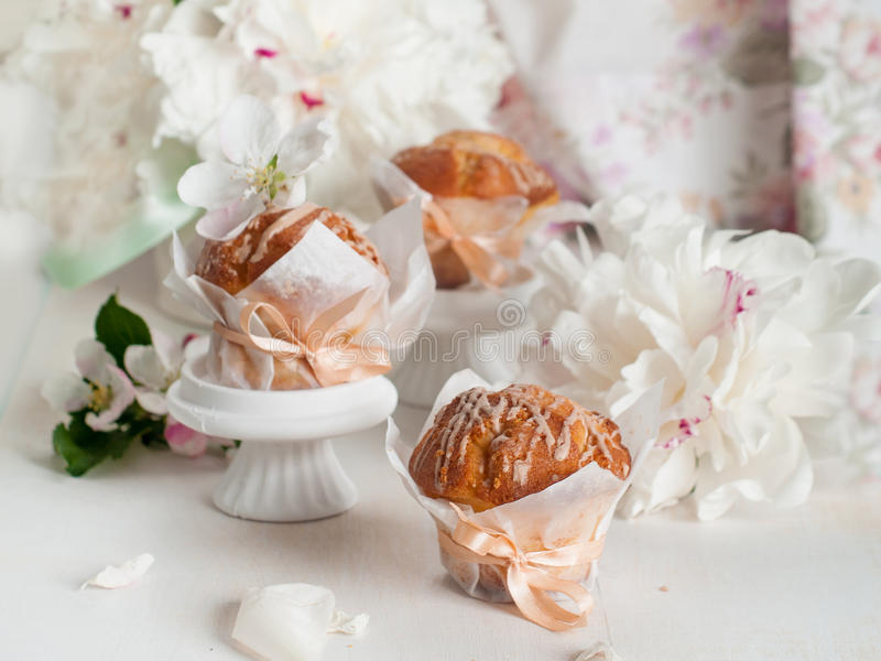 Cupcake or muffin with fresh flower stock photo