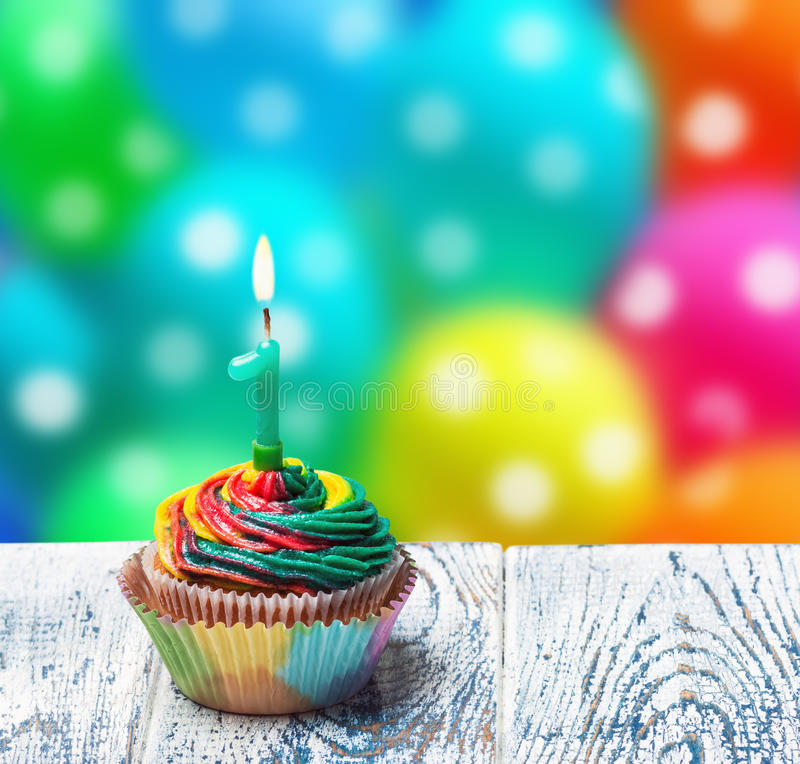 Cupcake with number one on the background of balloons royalty free stock photos