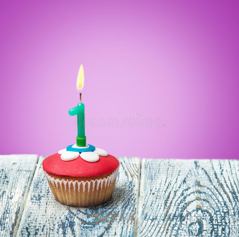 Cupcake with number one royalty free stock photography