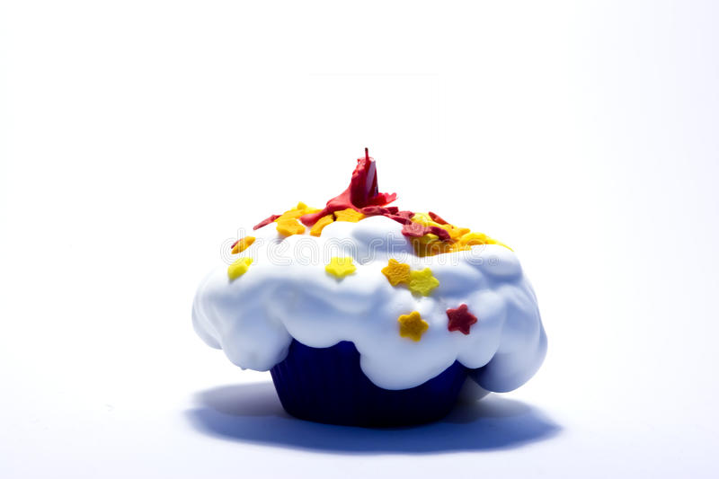 Cupcake party with a candle. Cupcake birthday or Christmas party stock photography