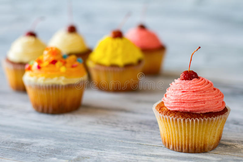 Cupcake with pink frosting. royalty free stock image