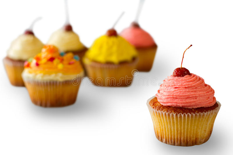 Cupcake with pink frosting. royalty free stock photography