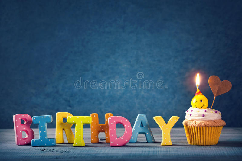 Cupcake with smiley candles royalty free stock images