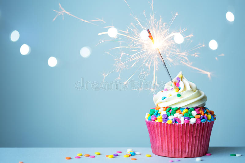 Cupcake with sparkler stock images