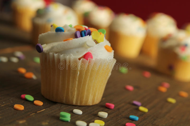 Download Cupcake with sprinkles stock image. Image of orange, sprinkles - 27788137