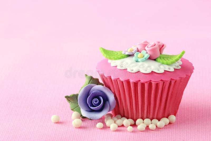 Cupcake. Sweet Cupcake with flower decoration in pink stock photos