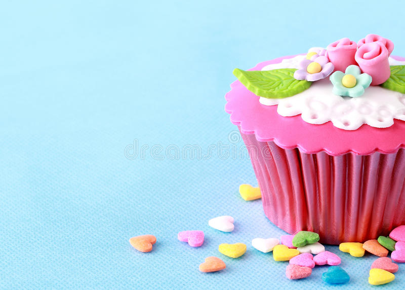Cupcake. Sweet Cupcake with flower decoration in pink royalty free stock photo