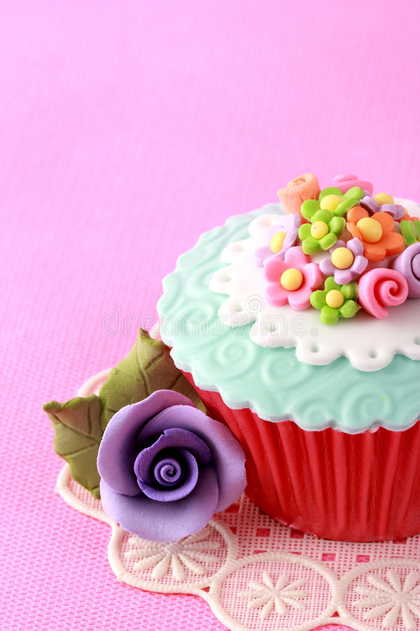 Cupcake. Sweet Cupcake with flower decoration in pink royalty free stock photos