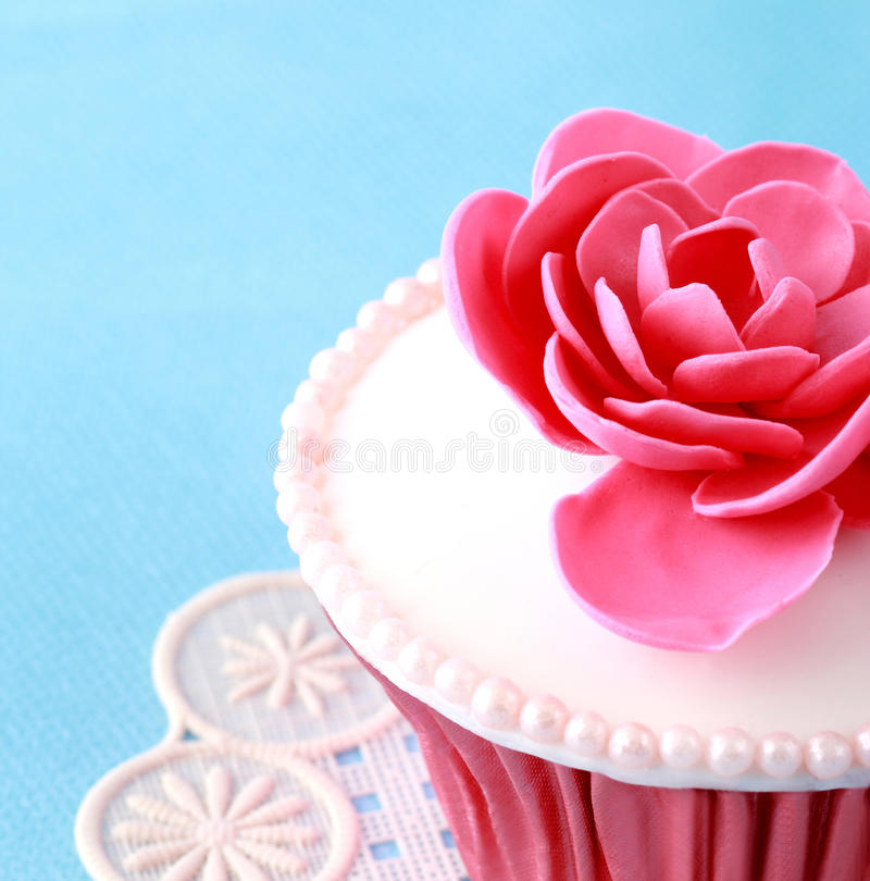 Cupcake. Sweet Cupcake with flower decoration in pink stock photography