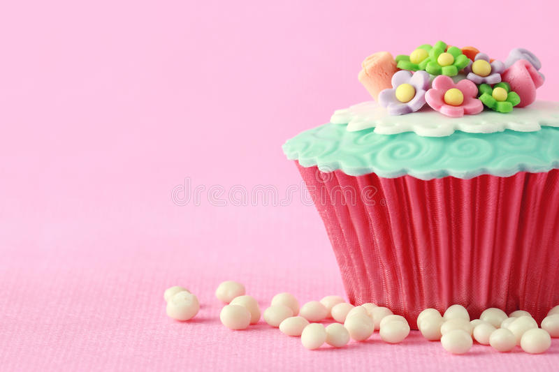 Cupcake. Sweet Cupcake with flower decoration in pink royalty free stock images