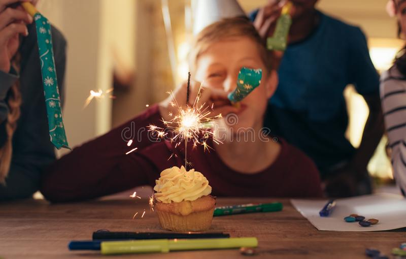 Kids celebrating at birthday party royalty free stock photography