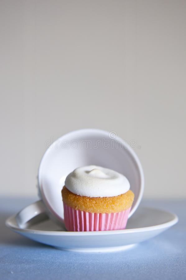 Cupcake and tea cup royalty free stock photo
