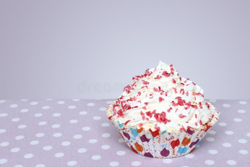 Cupcake. On vintage retro background stock photos