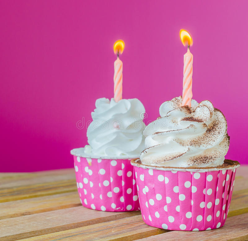 Cupcake. White cream cupcake with candle royalty free stock images