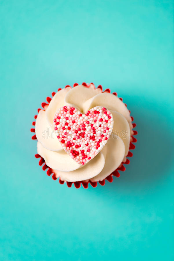 Cupcake with White Frosting and Candy Heart for Valentine`s Day royalty free stock photo