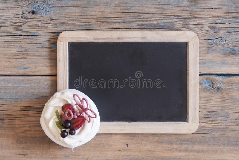 Cupcake on wooden table. royalty free stock image