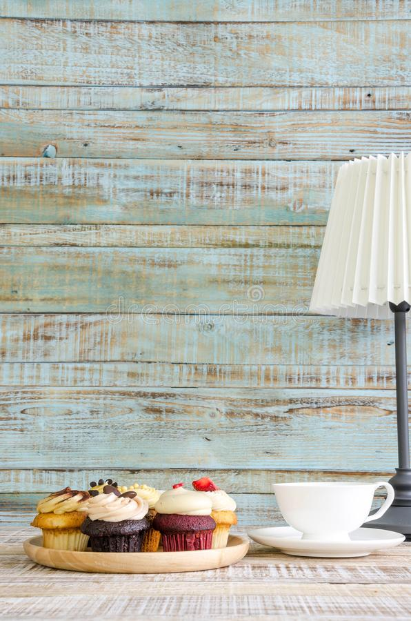 Cupcake on wooden table on vintage background royalty free stock photos