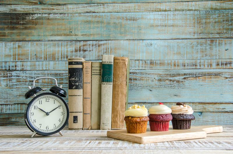 Cupcake on wooden table on vintage background royalty free stock images