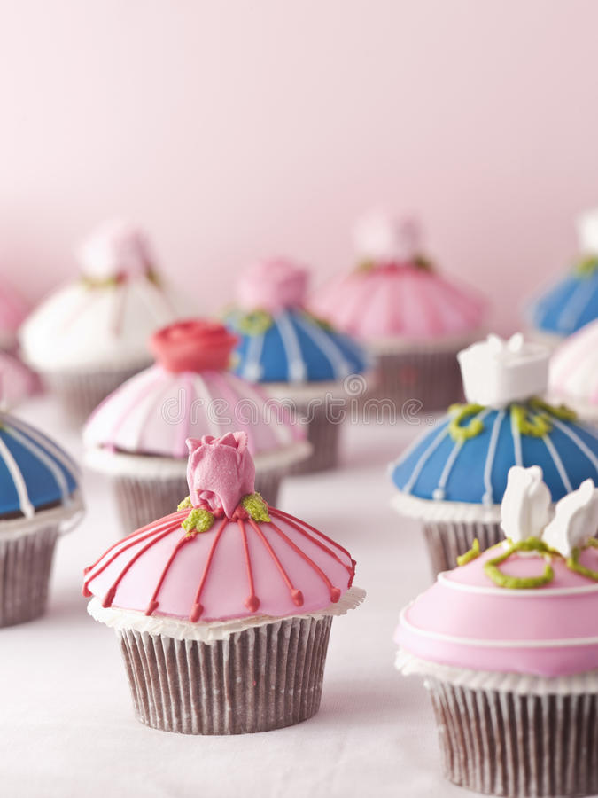 Cupcakes. Beautiful cupcake for birthday party in different colors royalty free stock images