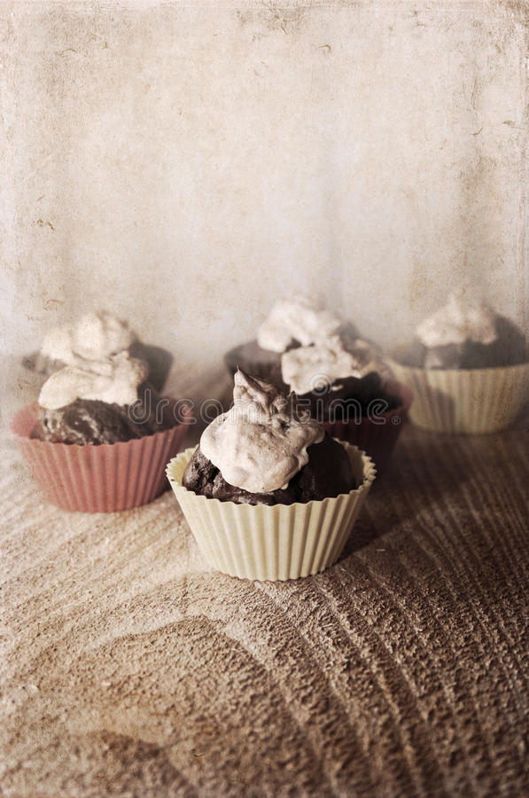 Cupcakes. Artwork in retro style, cupcakes royalty free stock photography