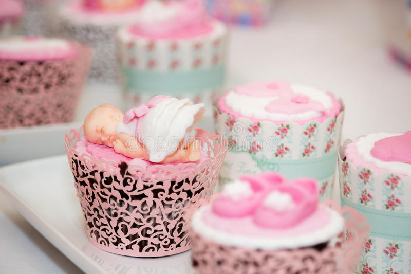 Cupcakes for a Baby Shower. Colourful Fondant Cupcakes for a Baby Girl Shower Party on a plate royalty free stock photography