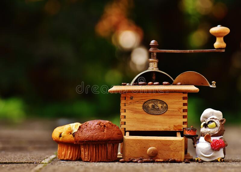 Cupcakes and coffee mill royalty free stock photo
