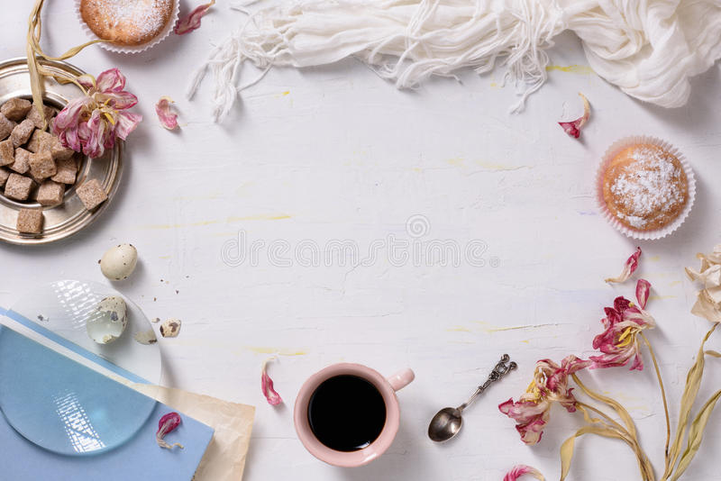 Cupcakes and coffee, morning light, food frame. Valentines or wedding day breakfast. Copy space, top view. stock images