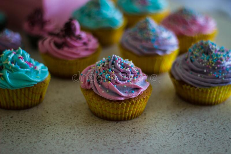 Cupcakes with colorful sprinkles royalty free stock photography