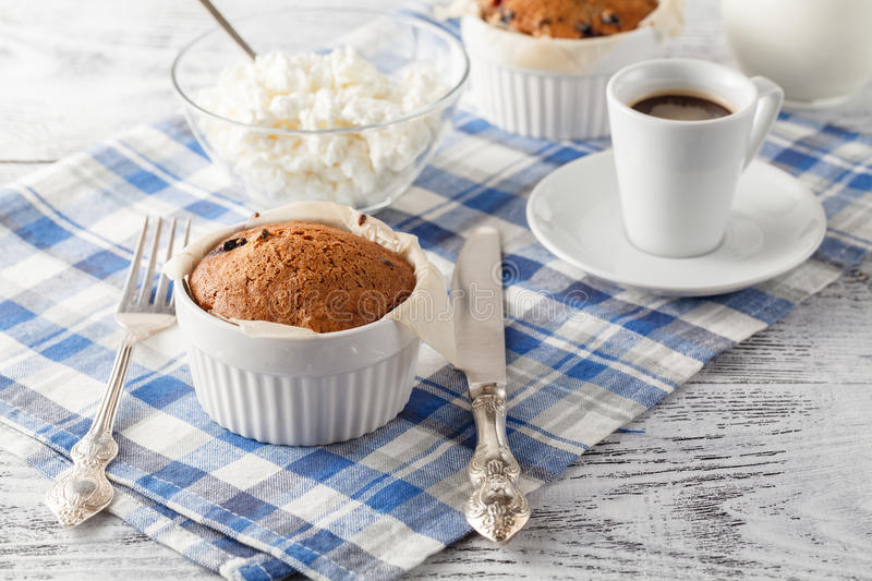 Cupcakes and cup of coffee on wooden table stock photos
