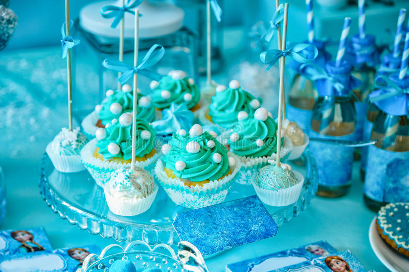 Cupcakes decorated with blue cream and sugar beads royalty free stock images