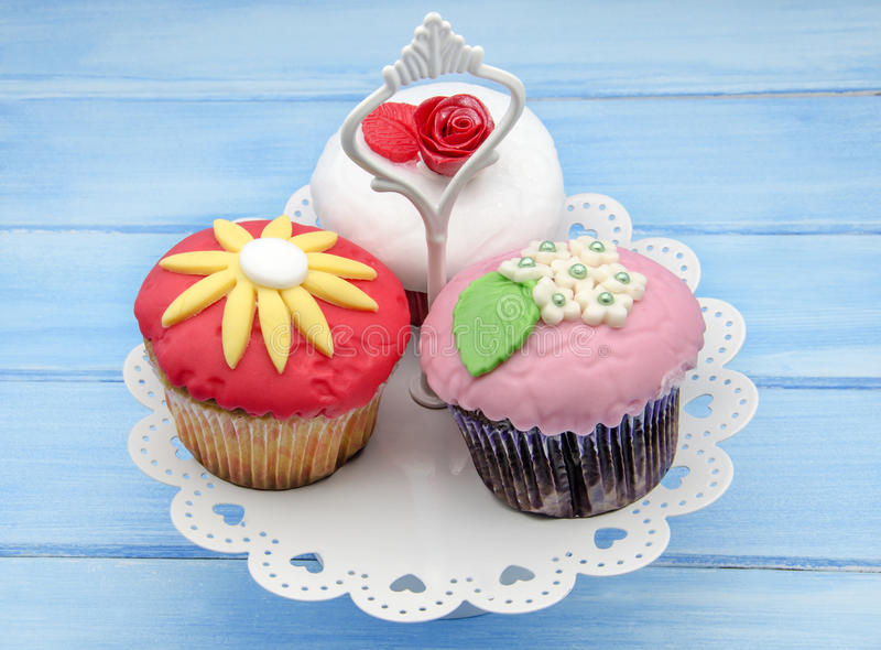 Cupcakes decorated. With fondant served on a tray royalty free stock photo