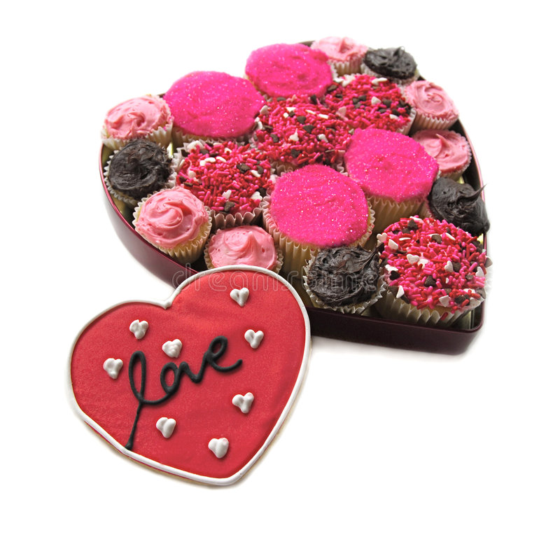 Cupcakes in heart shaped box with Love Cookie royalty free stock photography