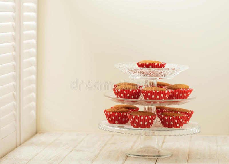 Cupcakes in paper red forms on a light wooden background. royalty free stock images