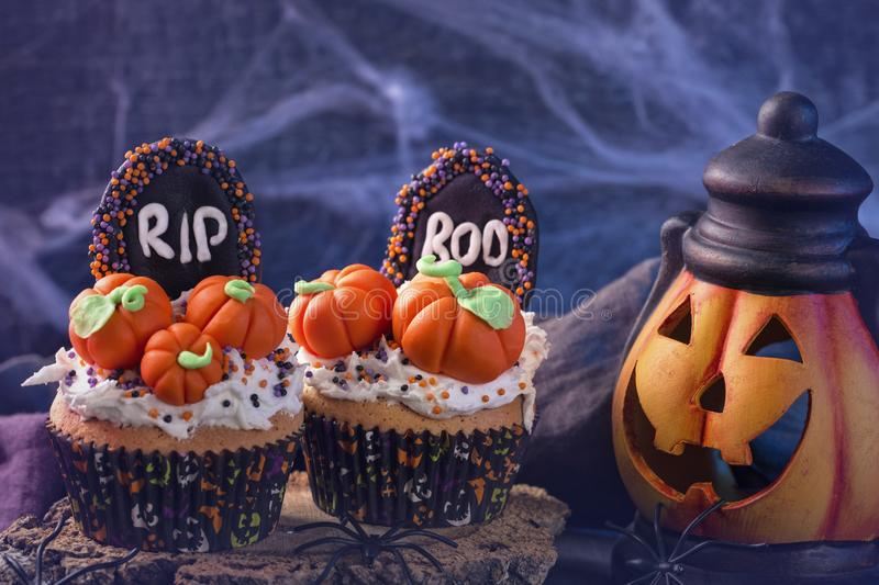 Cupcakes with pumpkins. For Halloween party stock image