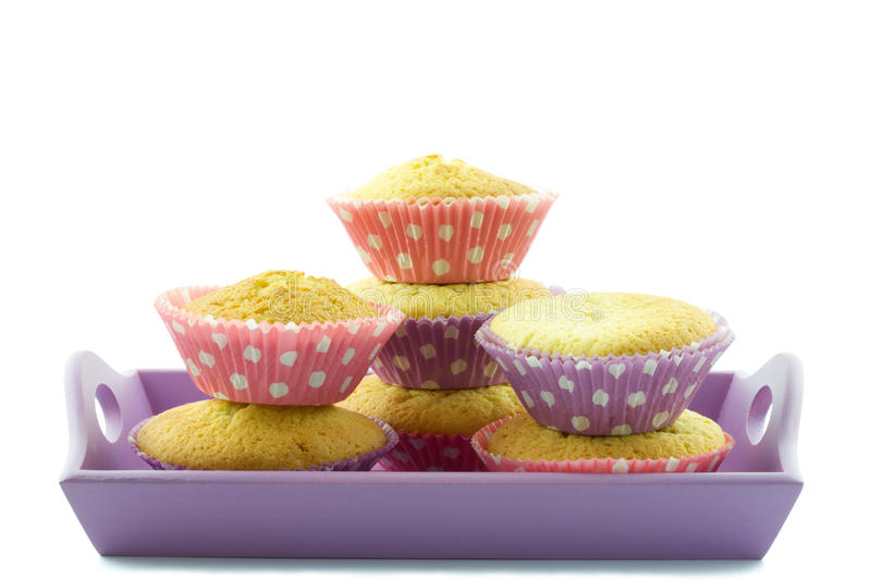 Cupcakes on a serving plate. Cupcakes on a purple serving plate isolated royalty free stock image