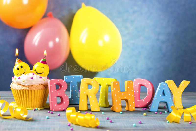 Cupcakes with smiley candles royalty free stock photos