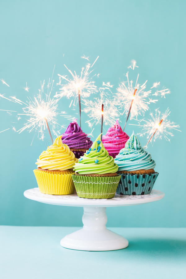 Cupcakes with sparklers stock images