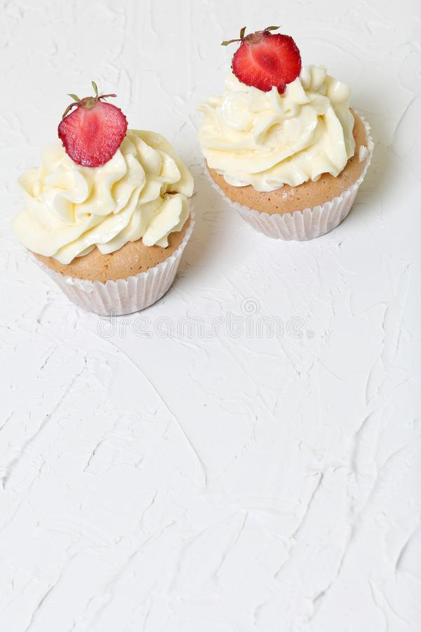 Cupcakes with strawberries and butter cream. stock photo