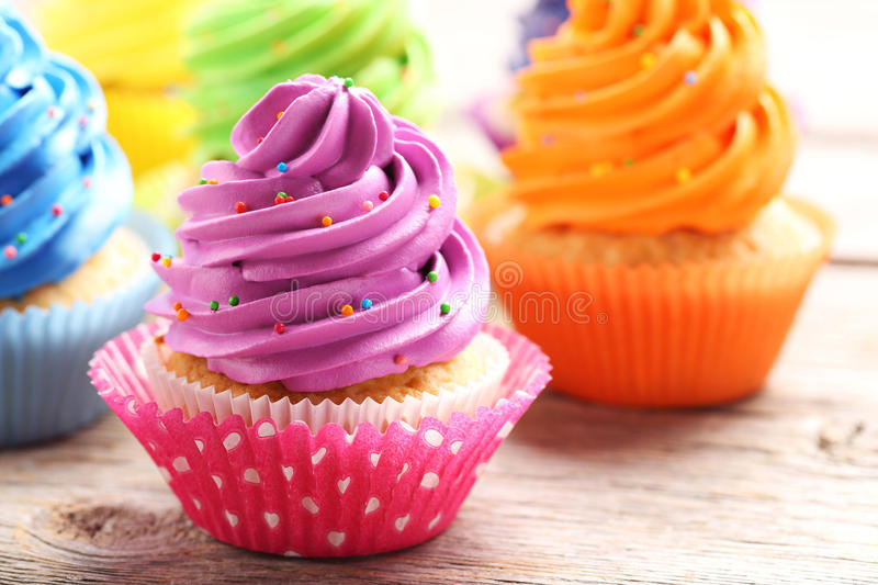 Cupcakes. Tasty cupcakes on a grey wooden table stock photography