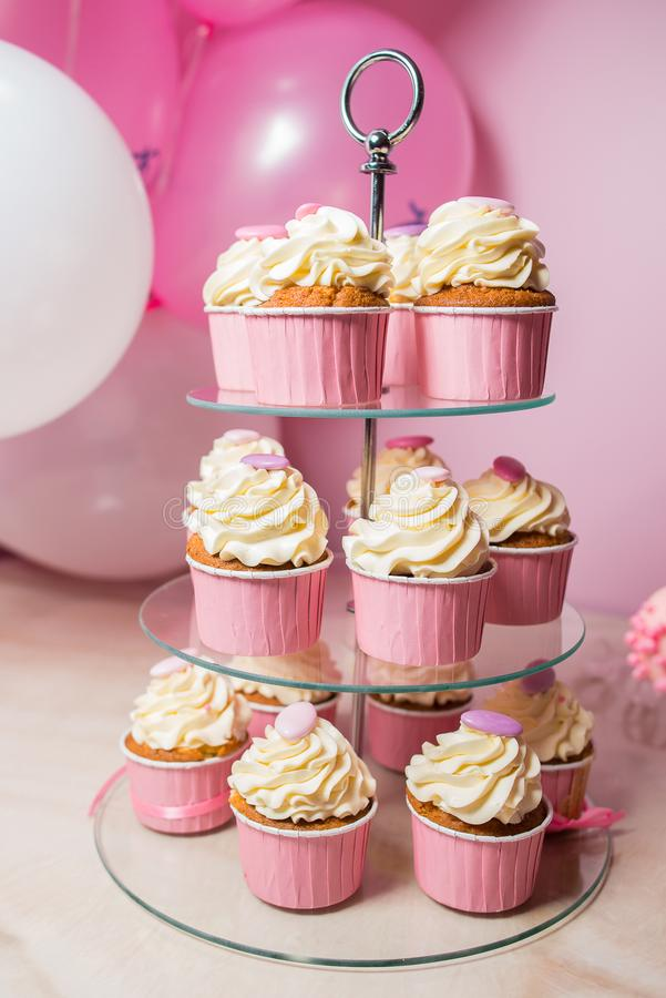 Cupcakes with vanilla cream on a stand stock photo