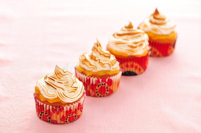 Cupcakes with whipped cream stock photos