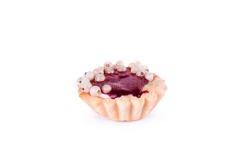 Cupcakes with white currants on a white background royalty free stock photo