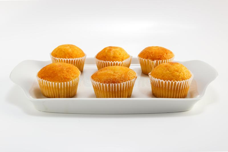 Cupcakes on a white plate on a light background stock image