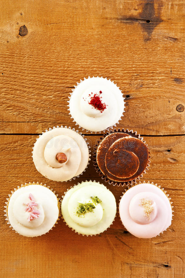 Cupcakes on wooden background. Sweets stock image